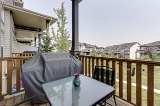 Photo 9: 39 Panatella Road NW in Calgary: Panorama Hills Row/Townhouse for sale : MLS®# A1124667