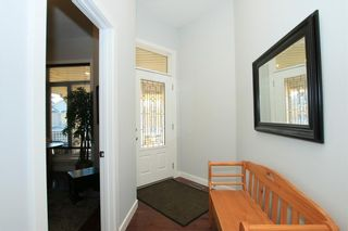Photo 4: 112 SUNSET Square: Cochrane House for sale : MLS®# C4113210