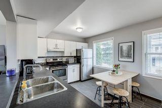 Photo 18: 341 Regal Park NE in Calgary: Renfrew Row/Townhouse for sale : MLS®# A1097610