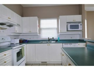 """Photo 2: 17 1765 PADDOCK Drive in Coquitlam: Westwood Plateau Townhouse for sale in """"WORTHING GREEN"""" : MLS®# V912013"""