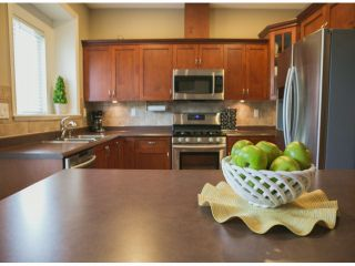 """Photo 7: 4 15168 66A Avenue in Surrey: East Newton Townhouse for sale in """"Porter's Cove"""" : MLS®# F1317928"""