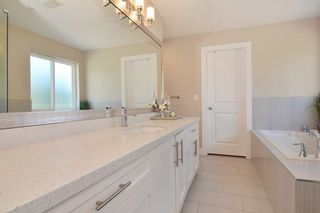 """Photo 12: 2701 CABOOSE Place in Abbotsford: Aberdeen House for sale in """"Station Woods"""" : MLS®# R2211880"""