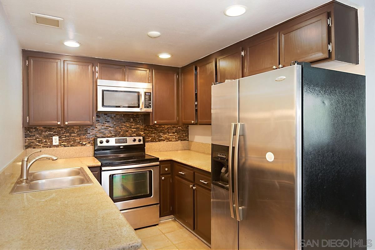 Main Photo: PARADISE HILLS Condo for sale : 3 bedrooms : 7049 Appian Dr #B in San Diego