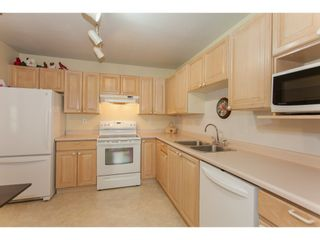 """Photo 9: 202 5955 177B Street in Surrey: Cloverdale BC Condo for sale in """"WINDSOR PLACE"""" (Cloverdale)  : MLS®# R2160255"""