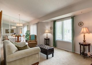 Photo 2: 143 Riverview Point SE in Calgary: Riverbend Row/Townhouse for sale : MLS®# A1129839