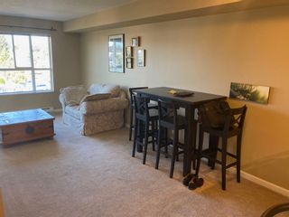 """Photo 1: 411 5465 203 Street in Langley: Langley City Condo for sale in """"Station 54"""" : MLS®# R2605677"""