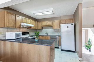 Photo 11: 1413 Ranchlands Road NW in Calgary: Ranchlands Row/Townhouse for sale : MLS®# A1133329