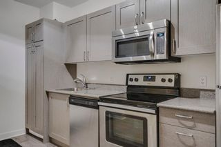 Photo 6: 504 30 Brentwood Common NW in Calgary: Brentwood Apartment for sale : MLS®# A1047644