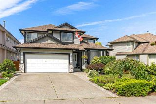 """Photo 1: 6863 183 Street in Surrey: Cloverdale BC House for sale in """"Cloverwoods"""" (Cloverdale)  : MLS®# R2394519"""