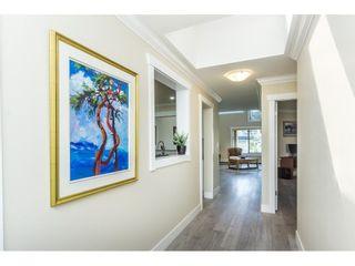 """Photo 2: 307 15270 17 Avenue in White Rock: King George Corridor Condo for sale in """"Cambridge 1"""" (South Surrey White Rock)  : MLS®# R2263148"""