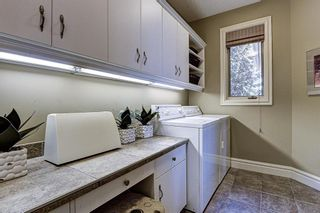 Photo 24: 251 Slopeview Drive SW in Calgary: Springbank Hill Detached for sale : MLS®# A1132385