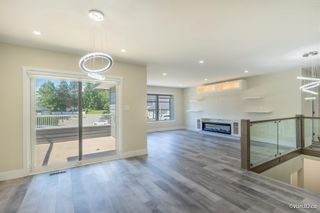 Photo 1: 5258 197 Street in Langley: Langley City House for sale : MLS®# R2595610