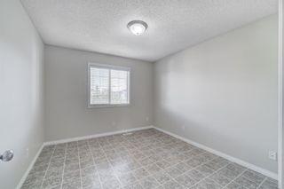 Photo 27: 4 136 Bow Ridge Drive: Cochrane Row/Townhouse for sale : MLS®# A1116097