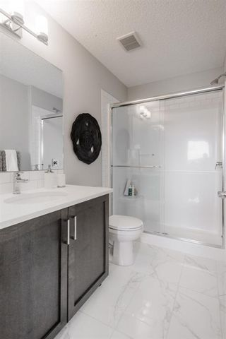 Photo 20: 606 16 Evanscrest Park NW in Calgary: Evanston Row/Townhouse for sale : MLS®# A1088021