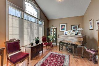 Photo 6: 206 GLENEAGLES View: Cochrane House for sale : MLS®# C4181281