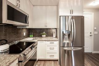"Photo 3: 308 6470 194 Street in Surrey: Clayton Condo for sale in ""Waterstone"" (Cloverdale)  : MLS®# R2622977"