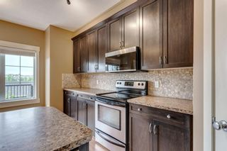 Photo 10: 320 Rainbow Falls Drive: Chestermere Row/Townhouse for sale : MLS®# A1114786
