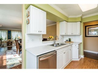 "Photo 13: 228 13880 70 Avenue in Surrey: East Newton Condo for sale in ""Chelsea Gardens"" : MLS®# R2563447"