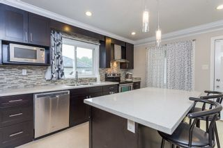 """Photo 5: 2731 DUKE Street in Vancouver: Collingwood VE House for sale in """"NORQUAY NEIGHNOURHOOD"""" (Vancouver East)  : MLS®# R2077238"""