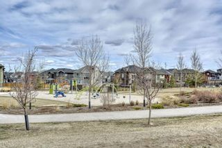Photo 2: 23 Sherwood Row NW in Calgary: Sherwood Row/Townhouse for sale : MLS®# A1100505
