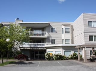 "Photo 1: 206 9946 151 Street in Surrey: Guildford Condo for sale in ""Westchester Place"" (North Surrey)  : MLS®# R2169746"
