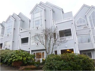 "Photo 1: 102 1330 GRAVELEY Street in Vancouver: Grandview VE Condo for sale in ""HAMPTON COURT-COMMERCIAL DRIVE"" (Vancouver East)  : MLS®# V1050258"