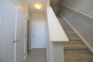 Photo 3: 296 Silverado Plains Park SW in Calgary: Silverado Row/Townhouse for sale : MLS®# A1065666
