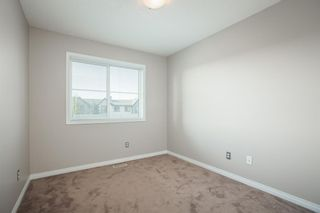 Photo 15: 8 Everridge Gardens SW in Calgary: Evergreen Row/Townhouse for sale : MLS®# A1041120