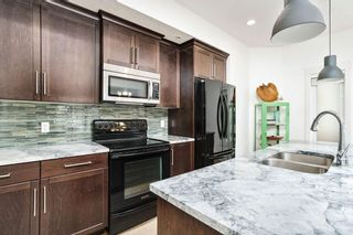 Photo 11: 1 4711 17 Avenue NW in Calgary: Montgomery Row/Townhouse for sale : MLS®# A1135461