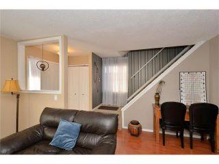 Photo 10: 10 GLENPATRICK Crescent: Cochrane House for sale : MLS®# C4094257