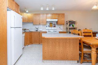Photo 3: 104 5220 50A Avenue: Sylvan Lake Row/Townhouse for sale : MLS®# A1146974