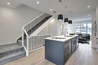 Photo 13: 3205 16 Street SW in Calgary: South Calgary Row/Townhouse for sale : MLS®# A1122787
