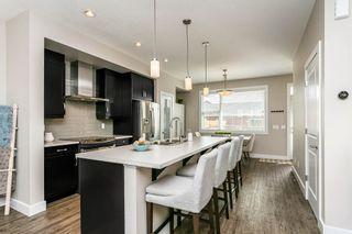 Photo 11: 1309 162 Street in Edmonton: Zone 56 House Half Duplex for sale : MLS®# E4248311
