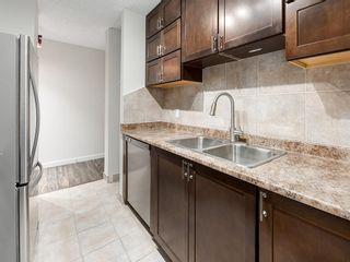 Photo 8: 1004 4944 DALTON Drive NW in Calgary: Dalhousie Apartment for sale : MLS®# C4305010