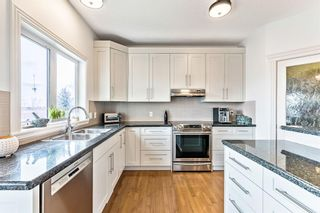 Photo 6: 52 Heritage Lake Mews: Heritage Pointe Detached for sale : MLS®# A1056186
