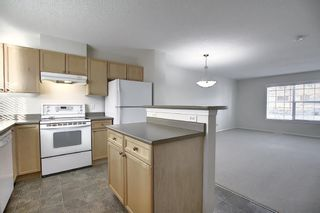 Photo 14: 25 Tuscany Springs Gardens NW in Calgary: Tuscany Row/Townhouse for sale : MLS®# A1053153