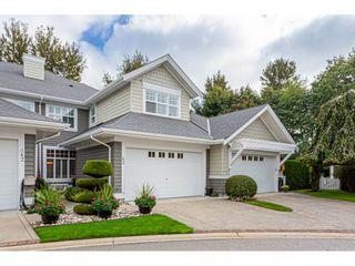 "Photo 1: 43 5900 FERRY Road in Ladner: Neilsen Grove Townhouse for sale in ""CHESAPEAKE LANDING"" : MLS®# R2505783"