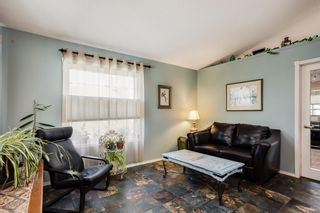 Photo 2: 84 Silver Creek Boulevard NW: Airdrie Detached for sale : MLS®# A1125089
