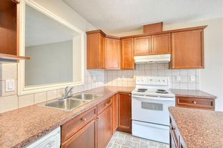 Photo 18: 66 Crystal Shores Cove: Okotoks Row/Townhouse for sale : MLS®# C4305435