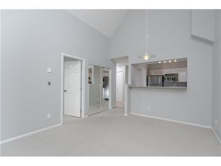 """Photo 11: 404 1200 EASTWOOD Street in Coquitlam: North Coquitlam Condo for sale in """"LAKESIDE TERRACE"""" : MLS®# V1123537"""