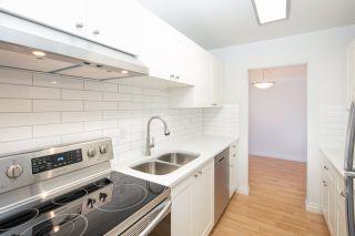 "Photo 1: 108 3411 SPRINGFIELD Drive in Richmond: Steveston North Condo for sale in ""BAYSIDE COURT"" : MLS®# R2151764"