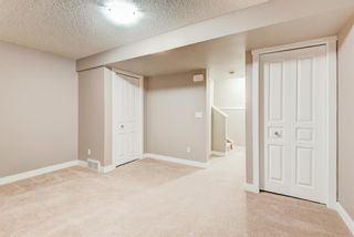 Photo 20: 100 28 Heritage Drive: Cochrane Row/Townhouse for sale : MLS®# A1076913