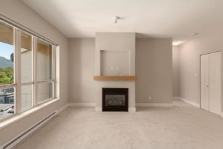 """Photo 4: 603 1211 VILLAGE GREEN Way in Squamish: Downtown SQ Condo for sale in """"ROCKCLIFF"""" : MLS®# R2573545"""