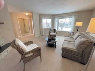 Photo 4: 15 Coach Side Terrace SW in Calgary: Coach Hill Row/Townhouse for sale : MLS®# A1071978