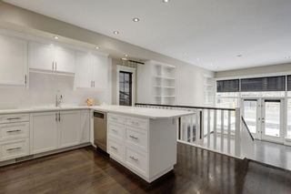 Photo 5: 1717 College Lane SW in Calgary: Lower Mount Royal Row/Townhouse for sale : MLS®# A1132774