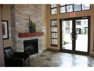 Photo 2: 310 2969 WHISPER Way in Coquitlam: Westwood Plateau Condo for sale : MLS®# V879520