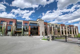 Photo 1: 303 15 Cougar Ridge Landing SW in Calgary: Patterson Apartment for sale : MLS®# A1095946