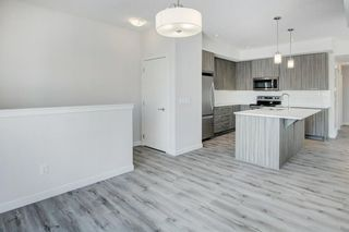 Photo 10: 502 115 Sagewood Drive: Airdrie Row/Townhouse for sale : MLS®# A1077274