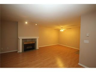 """Photo 4: 105 515 WHITING Way in Coquitlam: Coquitlam West Condo for sale in """"Brookside Manor"""" : MLS®# V903579"""