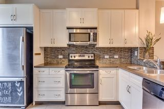 Photo 11: 54 Evansview Road NW in Calgary: Evanston Row/Townhouse for sale : MLS®# A1116817